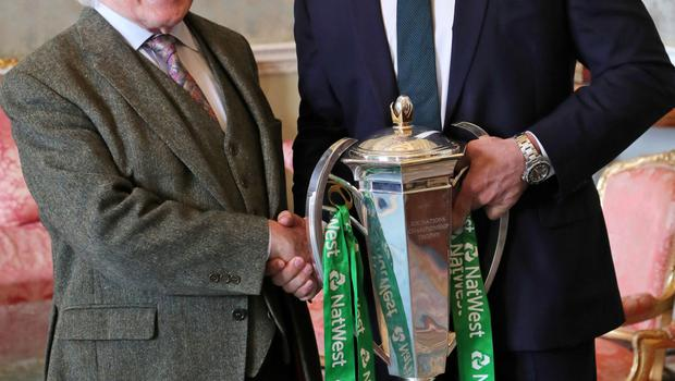 Ireland rugby captain Rory Best and Michael D Higgins with the Six Nations Trophy