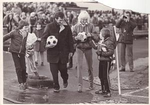 George Best's wife Angie hands out balls during the game