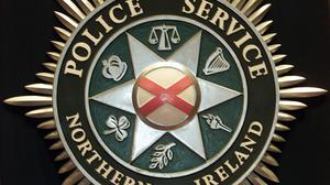 A man wearing a police uniform was involved in an attempted armed robbery of a shop in Portadown yesterday