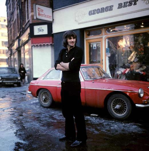 Style icon George Best outside his Manchester Boutique in the 1970s