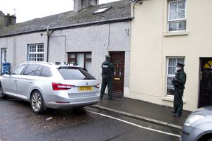 Attack: Police at the scene of the stabbing in Stream Street in Newry