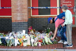 Floral tributes left near the scene of the attack at Forbury Gardens