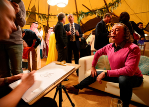 Miguel Angel Jimenez of Spain poses during a cartoon portrait sitting at the Arabian Nights Evening on Saturday night