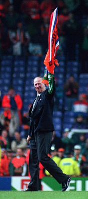 Charlton waves to fans after his final match in 1995