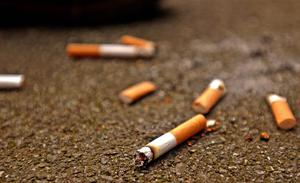 60% of surveyed areas had at least one cigarette butt present(Ken Lennox/PA)
