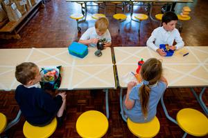 Children of essential workers eat lunch in segregated positions at Kempsey Primary School in Worcester last week