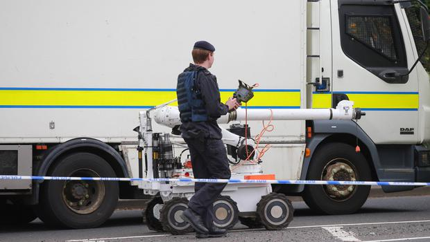 An Army expert at the scene of the bomb alert in west Belfast yesterday