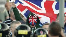 Protesters face police at Twaddell Avenue last year