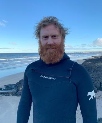 Help: surfer Al Mennie has been swimming at night for charity