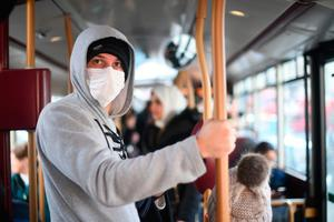 A commuter wears a face mask while taking a bus in Westminster, London, yesterday