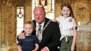 Frank McCoubrey with his children (PA)