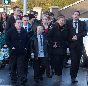Family and friends of the young DJ who was found dead at an apartment in west Belfast last week