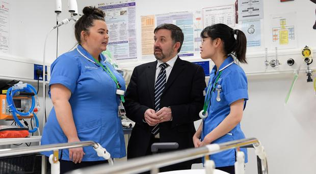 Health Minister Robin Swann with staff nurses Amber Loung and Gillian Browne in the emergency department of the Ulster Hospital