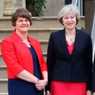 Arlene Foster and Theresa May at Stormont last year