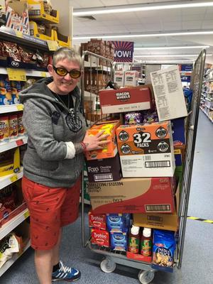 Kinship Care Volunteer, Cathy Stevenson loads up emergency for food parcels for hundreds of vulnerable elderly and young carers (Kinship Care/PA).