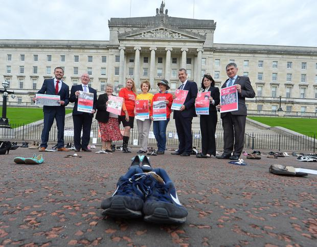 The Missing Millions protest at Stormont yesterday, at which shoes were laid to symbolise the individuals unable to attend because of ME
