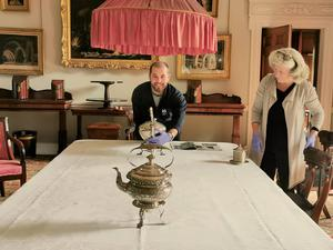 Matthew Morrison, House and Collections manager and Frances Bailey, curator, reinstate the dining room at The Argory ahead of reopening