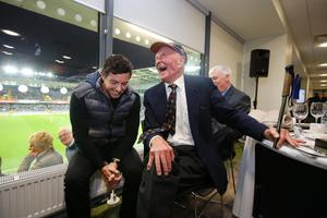 Harry shares a joke with Rory McIlroy ahead of a Northern Ireland match