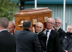 Sean Hughes (left), Spike Murray, Gerry Kelly and Gerry Adams carry Bobby Storey's coffin.