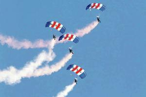 The RAF Falcons parachute display team putting on a colourful show