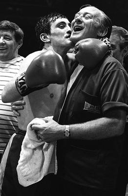 Barry McGuigan celebrates victory with manager Barney Eastwood after winning the European featherweight title at the King's Hall in Belfast