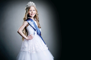 A child takes part in a beauty pageant - such an event is to be held in Belfast next month