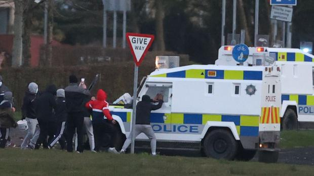 Youths attack a PSNI vehicle in the Nationalist area of Shantallow (Liam McBurney/PA)