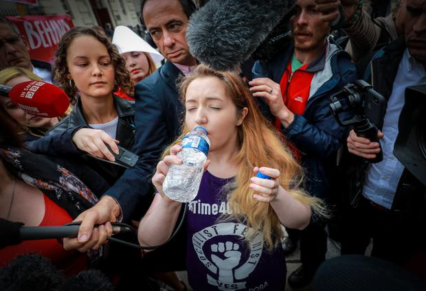 Activist Eleanor Crossey-Malone takes what appears to be an abortion pill
