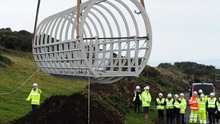 A tubular bridge section of the restored Gobbins cliff path is hoisted into place late last year