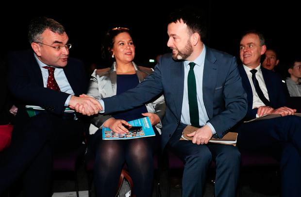 Fianna Fail deputy leader Dara Calleary (left) shakes hands with SDLP leader Colum Eastwood as Sinn Fein leader May Lou MacDonald looks on at the Belfast conference at weekend