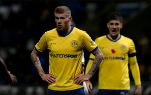 James McClean playing for Wigan on Saturday wearing his poppy-free shirt
