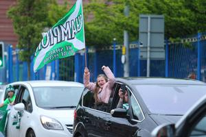 Celtic fans took to the streets of west Belfast last night to celebrate their team's ninth league title in a row
