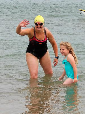 Heather Clatworthy and daughter Lilly after she swam from Stroove beach in Co Donegal to Portstewart