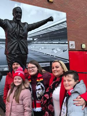 The family on a trip to Anfield football ground