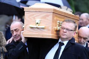 Alan Clarke (left) carries the remains of his daughter from Aghavea Church