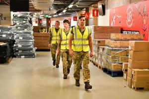 The British Army help move medical supplies at the Principality Stadium, Cardiff, which is being turned into a 2000-bed hospital to help fight coronavirus. (Ben Birchall/PA)