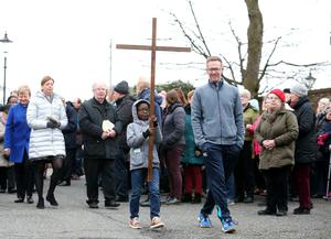 Clergy from the Ormeau Road in Belfast join together to carry the cross