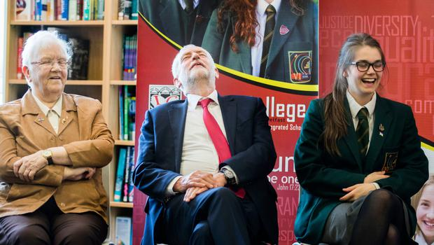 The Labour leader listening to a joke with Baroness May Blood and student Madaline Kelly during a visit to Lagan College