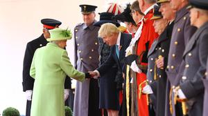 Mr Johnson bowed as he shook hands with the Queen