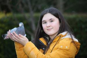 UK Young Pigeon Fancier of the Year Keelie Wright with one of her race pigeons