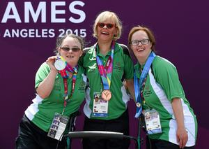Nuala celebrates with team-mates Rita Quirke, who won bronze, and Nicola Higgins, who won a fifth-place ribbon