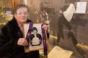 Kay Duddy with a picture of her brother Jackie and the stole worn by Bishop Edward Daly as he administered the last rites on Bloody Sunday