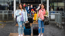 Aleksanda Sabalina (left) and Edith Mikutenaite, who live in Newtownabbey, leave Belfast International Airport after arriving from Barcelona yesterday