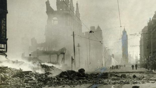The Albert Clock stands tall amid the rubble and ruins of High Street