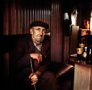 Frank Campbell, aged 75, known popularly as 'Wings' Campbell, drinking Guinness