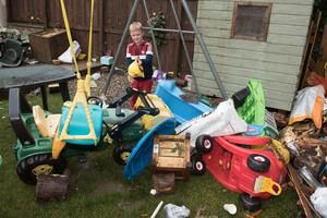 Matthew Smith (8) with his ruined toys