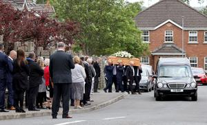 The funeral of Andrew Abraham at his home in Waringstown