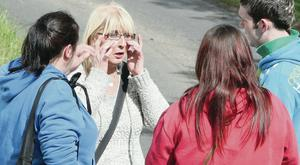 Kathleen Arkinson is comforted by family members as police search the outskirts of Castlederg, Co Tyrone, for Arlene in 2011