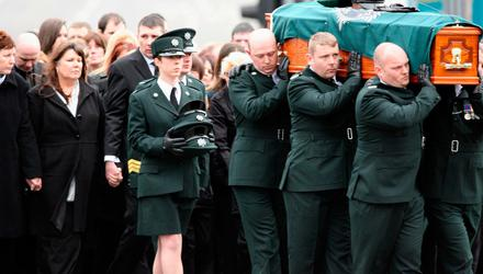 Kate Carroll following her husband Stephen's coffin in 2009. He was murdered while on duty in 2009