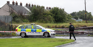 Police at the scene of a shooting in Carrickfergus on Sunday evening